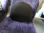 Lower back support cushion providing relief from back pain on the train