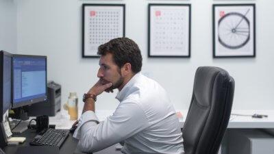 Bad posture - Man slouching over a desk